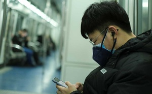A man wearing two face masks travels in the subway, as the country is hit by an outbreak of the new coronavirus, in Beijing, China Jan 26, 2020. REUTERS