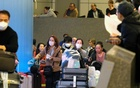FILE PHOTO: Passengers arrive at LAX from Shanghai, China, after a positive case of the coronavirus was announced in the Orange County suburb of Los Angeles, California, US, Jan 26, 2020. REUTERS