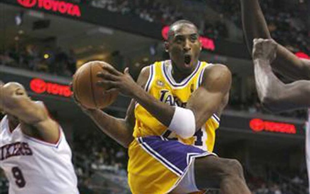 File Photo: Los Angeles Lakers forward Kobe Bryant (24) heads to the basket past the defense of the Philadelphia 76ers forward Andre Iguodala (9) during the fourth quarter of their NBA basketball action in Philadelphia, Pennsylvania December 21, 2007. Reuters