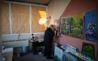 Artist Stamen Karamfilov works on a painting at his studio in the city of Plovdiv, Bulgaria, Jan 23, 2020. REUTERS/FILE