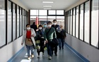 Passengers wearing masks arrive at the Tribhuvan International Airport after Nepal confirmed the first case of coronavirus in the country, in Kathmandu, Nepal Jan 28, 2020. REUTERS