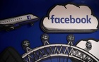 Facebook branding is seen in a workspace at the company's offices in London, Britain, January 20, 2020. REUTERS