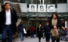 Pedestrians walk past a BBC logo at Broadcasting House, as the corporation announced it will cut around 450 jobs from its news division, in London, Britain January 29, 2020. Reuters