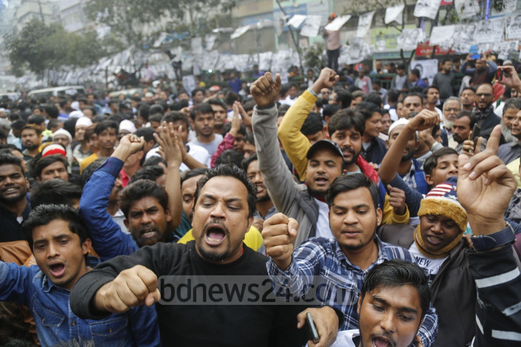 Supporters chant slogans at the campaign of Ishraque Hossain, the BNP's mayoral candidate in the South.
