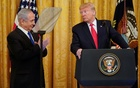 US President Donald Trump looks over at Israel's Prime Minister Benjamin Netanyahu during a joint news conference to announce a new Middle East peace plan proposal in the East Room of the White House in Washington, US, January 28, 2020. Reuters