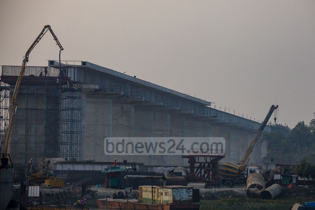 The work to build Rupsa Railway Bridge, part of a project to link Khulna and Mongla, is under way. Photo: Mostafigur Rahman