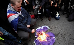 A man burns an EU flag on Brexit day in London, Britain January 31, 2020. Reuters