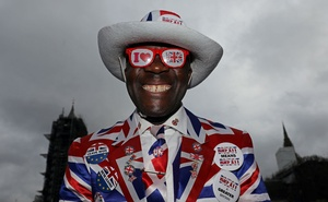 A pro-Brexit supporter smiles as he poses on Parliament Square, on Brexit day, in London, Britain January 31, 2020. Reuters
