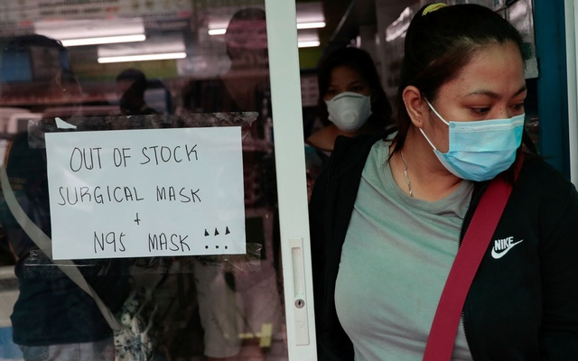A sign is posted on a medical supply store that says surgical and N95 masks are already out of stock, in Manila, Philippines, January 31, 2020. REUTERS