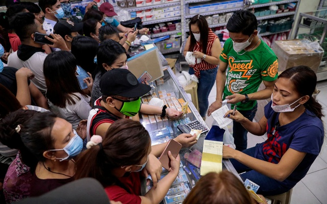 People scramble to buy face masks in a medical supply store a day after the Philippine government confirmed the first novel coronavirus case, in Manila, Philippines, January 31, 2020. REUTERS