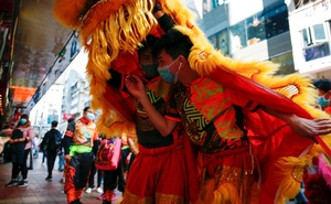 Performers wear masks to prevent an outbreak of a coronavirus as they perform a traditional Chinese lion dance to mark the Chinese Lunar New Year, in Hong Kong, China January 31, 2020. REUTERS