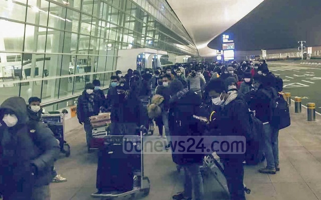 Masked Bangladeshis entering Tianhe International Airport in the Chinese city of Wuhan on Friday for evacuation from the epicentre of a deadly coronavirus outbreak.