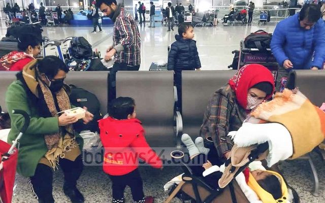 Bangladeshis waiting to board a special flight at Tianhe International Airport in the Chinese city of Wuhan on Friday for evacuation from the epicentre of a deadly coronavirus outbreak.