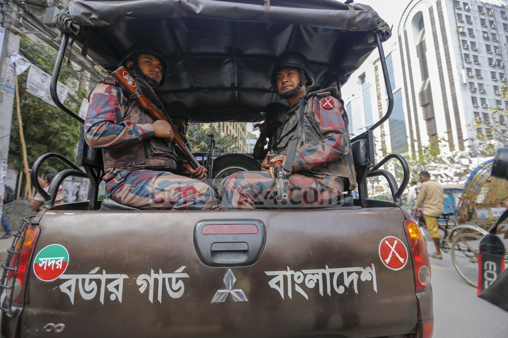 Members of law enforcement were put on alert in various parts of Dhaka on Sunday as part of the security measures due to the city elections. Photo: Mahmud Zaman Ovi