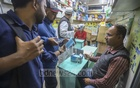 Customers buying protective masks at a store in the Bangladesh Medical Association building in Dhaka on Sunday amid the outbreak of a novel coronavirus in China. Photo: Asif Mahmud Ove