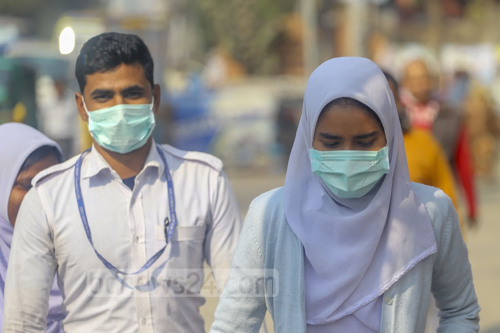 Students sporting surgical masks return home after their SSC tests in Dhaka's Tejgaon on Monday. Photo: Asif Mahmud Ove