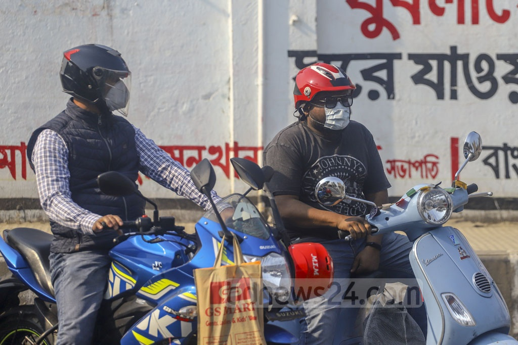 Motorcyclists wearing surgical masks to prevent catching a deadly coronavirus infection which has spread to 27 countries around the world after breaking out in China. Photo: Asif Mahmud Ove