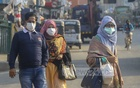 The use of face masks has increased in Bangladesh as a deadly coronavirus originating in China threatens to become a global pandemic. Photo: Asif Mahmud Ove