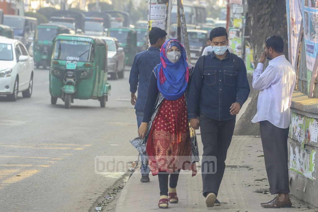 People wearing surgical masks outside to prevent catching a deadly coronavirus which has originated in China and spread to various countries across the globe. Photo: Asif Mahmud Ove