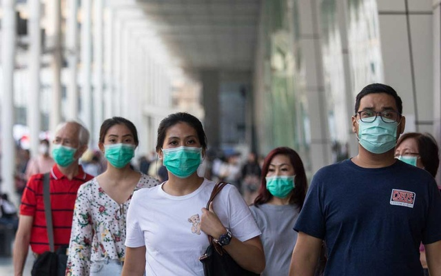Pedestrians wear face masks in Bangkok, Jan 31, 2020. The Wuhan coronavirus spreading from China is now likely to become a pandemic that circles the globe, according to many of the world's leading infectious disease experts. (Amanda Mustard/The New York Times)