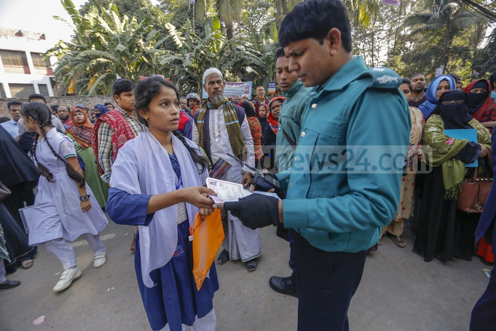 Law enforcers assisting a student outside an SSC examination centre in Dhaka on Monday. Photo: Mahmud Zaman Ovi