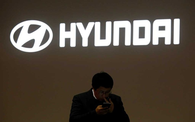 FILE PHOTO: A man walks past the logo of Hyundai Motor during the 2019 Seoul Motor Show in Goyang, South Korea, March 28, 2019. Reuters