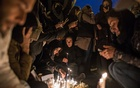 People hold a vigil in honour of those who died when the Iranian military accidentally shot down a Ukrainian passenger jet with a missile, in Tehran, Iran, Jan 11, 2020. The New York Times