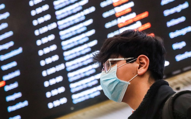 A passenger wears a protective mask at Sheremetyevo International Airport outside Moscow, Russia Feb 4, 2020. REUTERS