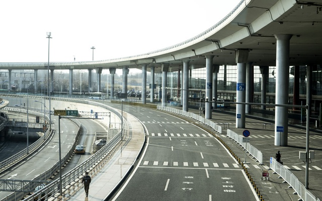 A nearly deserted road outside Beijing Capital International Airport, which is usually choked with traffic, in China on Feb 3, 2020. The Chinese capital, like other cities far from the epidemic's centre, has imposed restrictions and shut down public spaces, straining the ties that bind society. (Giulia Marchi/The New York Times)