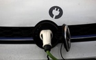 FILE PHOTO: A car is plugged in at a charging point for electric vehicles in London, Britain, Mar 6, 2018. REUTERS