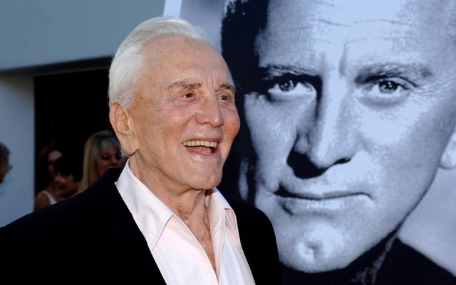 FILE PHOTO: Actor Kirk Douglas arrives to receive an inaugural award for Excellence in film presented by the Santa Barbara International Film Festival at a black-tie gala fundraiser in his honor at the Bacara Resort & Spa in Santa Barbara, California, Jul 30, 2006. REUTERS