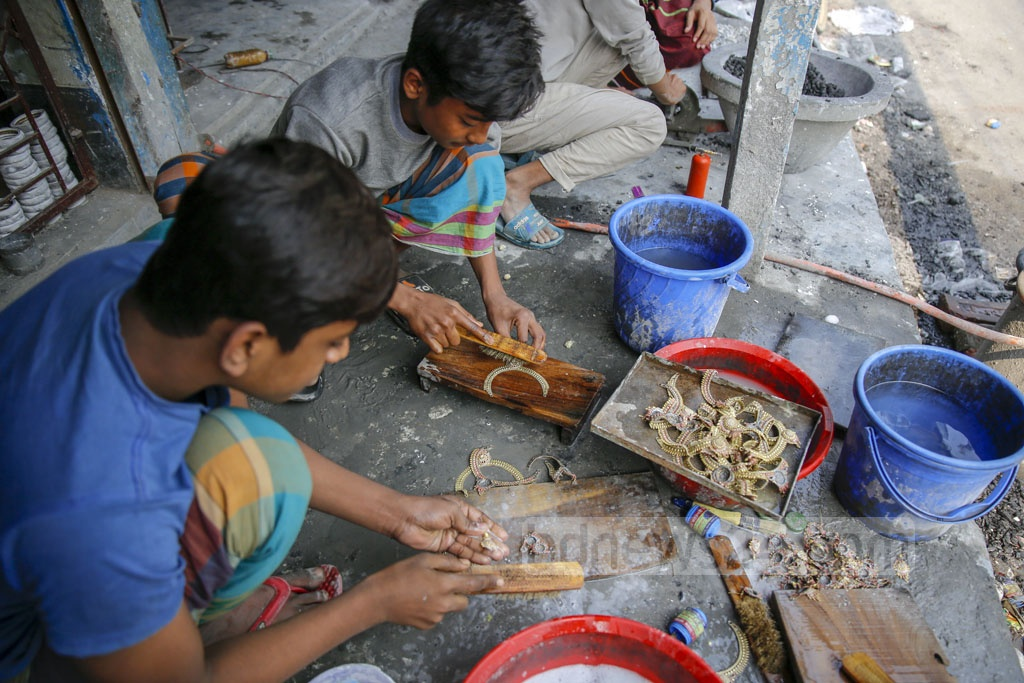 Each member of the family, including the children, is somehow involved in the making of jewellery. Photo: Mahmud Zaman Ovi
