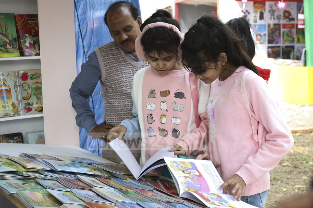 Children face a dilema over which book to buy at the Amar Ekushey Book Fair on Friday. Photo: Asif Mahmud Ove