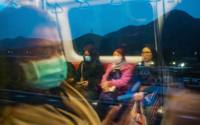 Some people ride the MTR train in Hong Kong wearing masks on Tuesday, Feb 4, 2020. The death toll and the number of coronavirus infections continued to soar in China, according to official data released early Friday. (Billy HC Kwok/The New York Times)