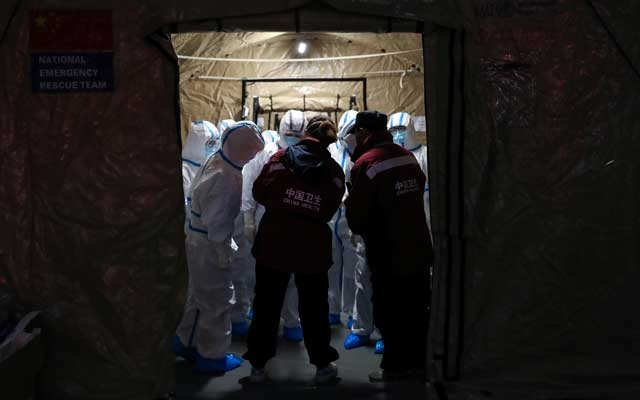 Medical workers in protective suits are seen at the Wuhan Parlour Convention Centre, which has been converted into a makeshift hospital following an outbreak of the novel coronavirus, in Wuhan, Hubei province, China Feb 7, 2020. REUTERS