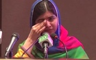 Malala Yousafzai cries as she delivers her first speech back in her homeland in 2018. Reuters