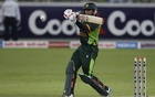 Pakistan's Nasir Jamshed plays a shot during their second Twenty20 international cricket match against South Africa in Dubai Nov 15, 2013. REUTERS