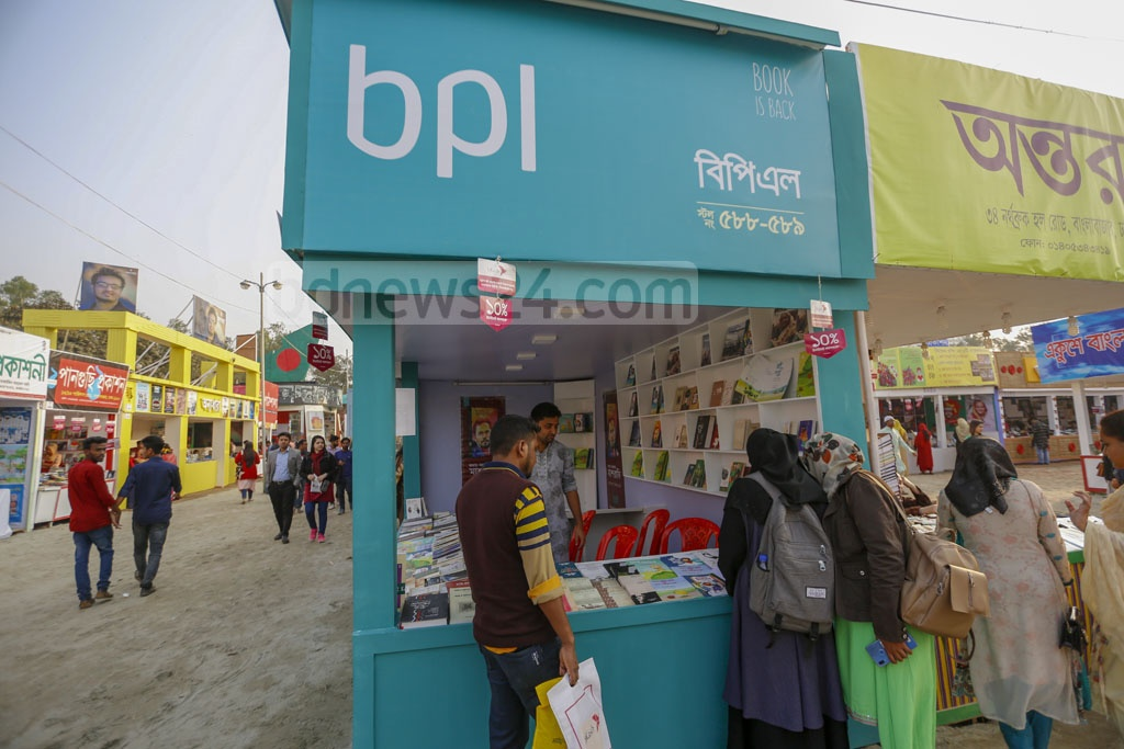 Book-lovers visit the stall of bdnews24 publishing limited or bpl at the Suhrawardy Udyan during the Amar Ekushey Book Fair on Sunday.