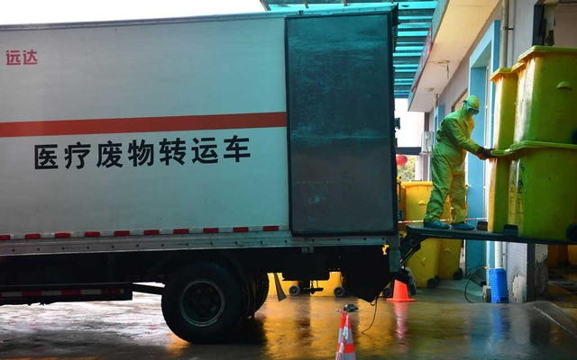 A worker in protective suit transports medical waste from a truck at a medical waste disposal centre following an outbreak of the novel coronavirus in the country, in Chengdu, Sichuan province, China Feb 8, 2020. REUTERS