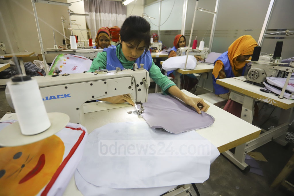 Workers making schoolbags from election campaign banners. Photo: Asif Mahmud Ove