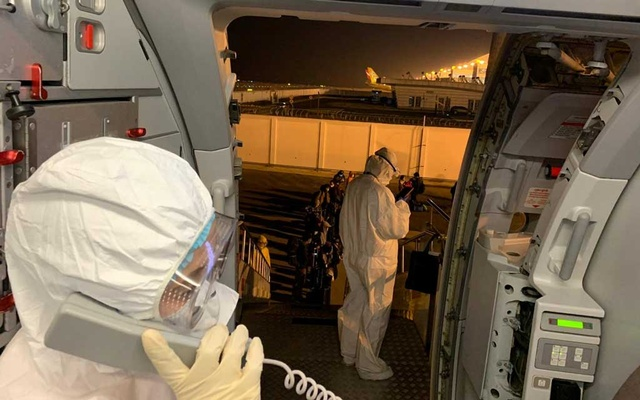 Filipinos, voluntarily evacuated due to the coronavirus outbreak, board a plane from Wuhan, Hubei, China, February 9, 2020. Courtesy of Department of Foreign Affairs/Handout via REUTERS