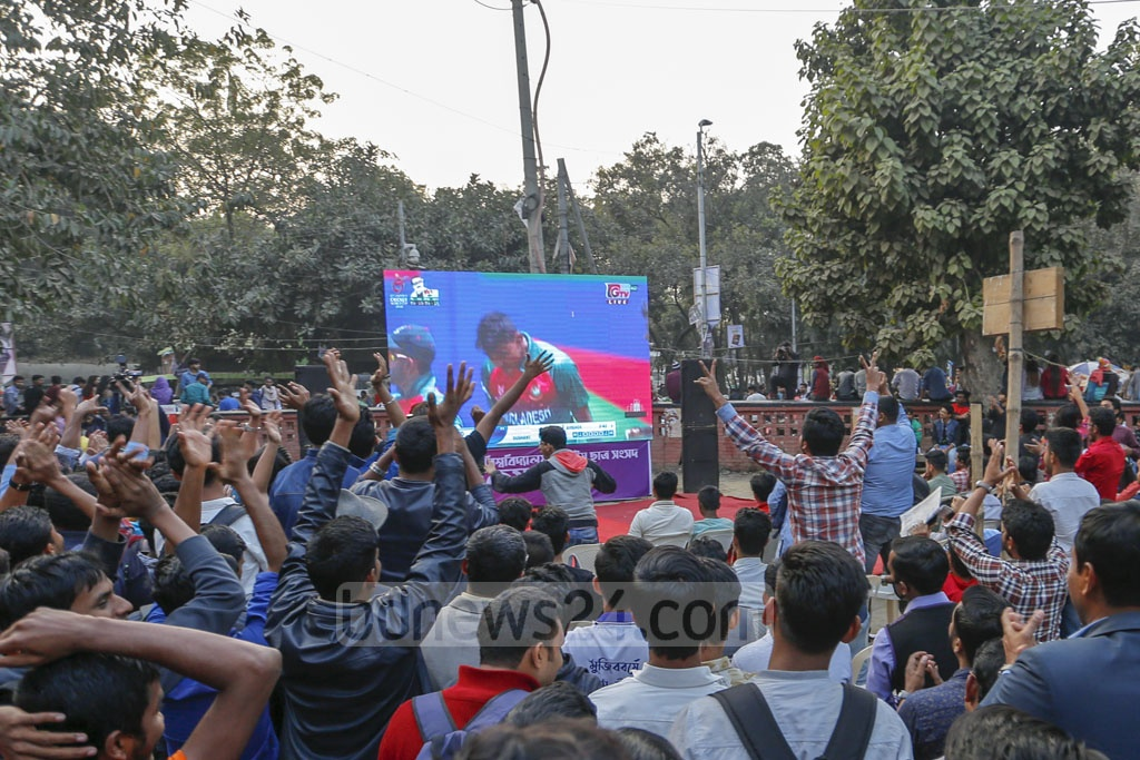 Fans celebrate as they watch the Bangladesh-India final match of the ICC U19 Cricket World Cup on a giant screen at the Dhaka University's TSC on Sunday. The young Tigers went on to win the first global crown for the country in a tense game.