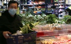 A man wearing a face mask shops for vegetables inside a fresh food store following an outbreak of the novel coronavirus in Wuhan, Hubei province, China Feb 8, 2020. REUTERS