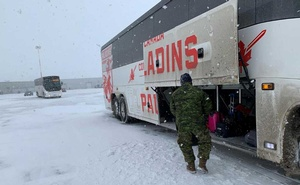 Canadian Forces personnel load luggage onto a bus for Canadians, who had been evacuated from China on an American charter plane due to the outbreak of novel Coronavirus. REUTERS