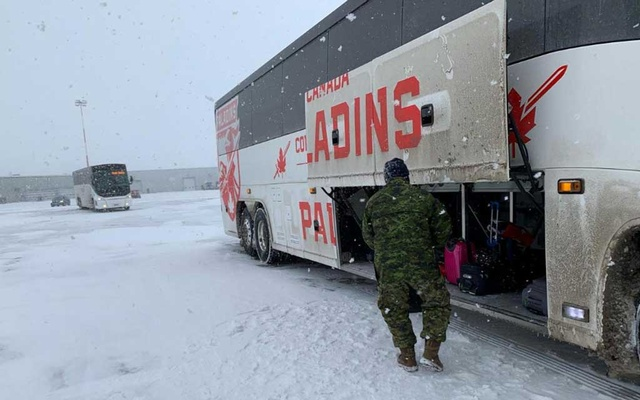 Canadian Forces personnel load luggage onto a bus for Canadians who had been evacuated from China on an American charter plane due to the outbreak of novel Coronavirus. REUTERS