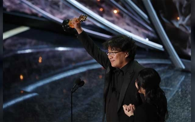 Director Bong Joon-ho accepts the Oscar for Best Foreign Language Film for 'Parasite' of South Korea at the 92nd Academy Awards in Hollywood, Los Angeles, California, US, Feb 9, 2020. REUTERS
