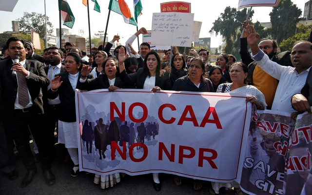 Lawyers carrying placards and banners shout slogans during a protest against a new citizenship law, in Ahmedabad, India, Feb 10, 2020. REUTERS