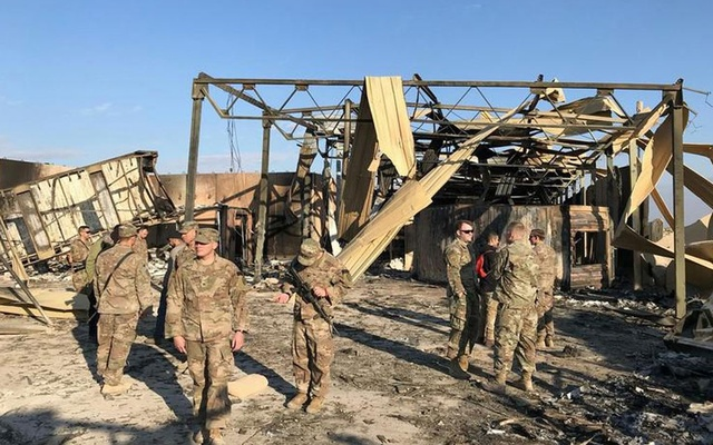 US soldiers are seen at the site where an Iranian missile hit at Ain al-Asad air base in Anbar province, Iraq. REUTERS