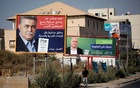 A Labour party election banner depicting party leader Amir Peretz and writing in Arabic reading
