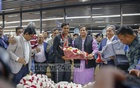 State Minister for Youth and Sports Zahid Ahsan Russell garlanding Akbar Ali, the under-19 cricket team captain and hero of Bangladesh's victory in the final of the World Cup against India, at the Dhaka airport on Wednesday. Photo: Mahmud Zaman Ovi